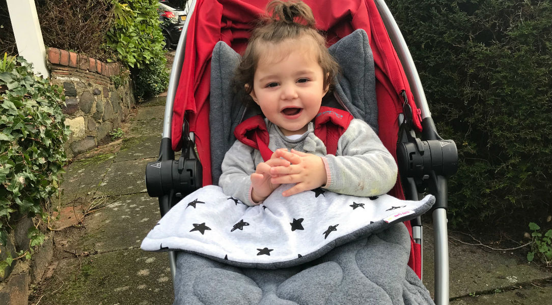 Evie-Grace keeping warm in her buggy with the Minene Footmuff