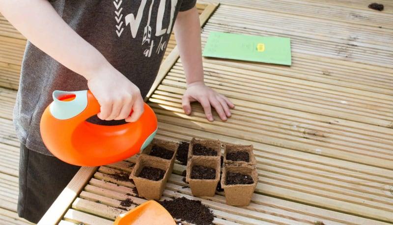 Isaac using the Sembra Kids garden kits