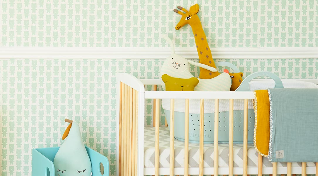 Wooden KIDLY two tone cot with OYOY animal cushions