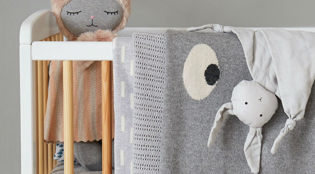Introduce blankets from The Bonnie Mob and cushions to create a soft nursery look