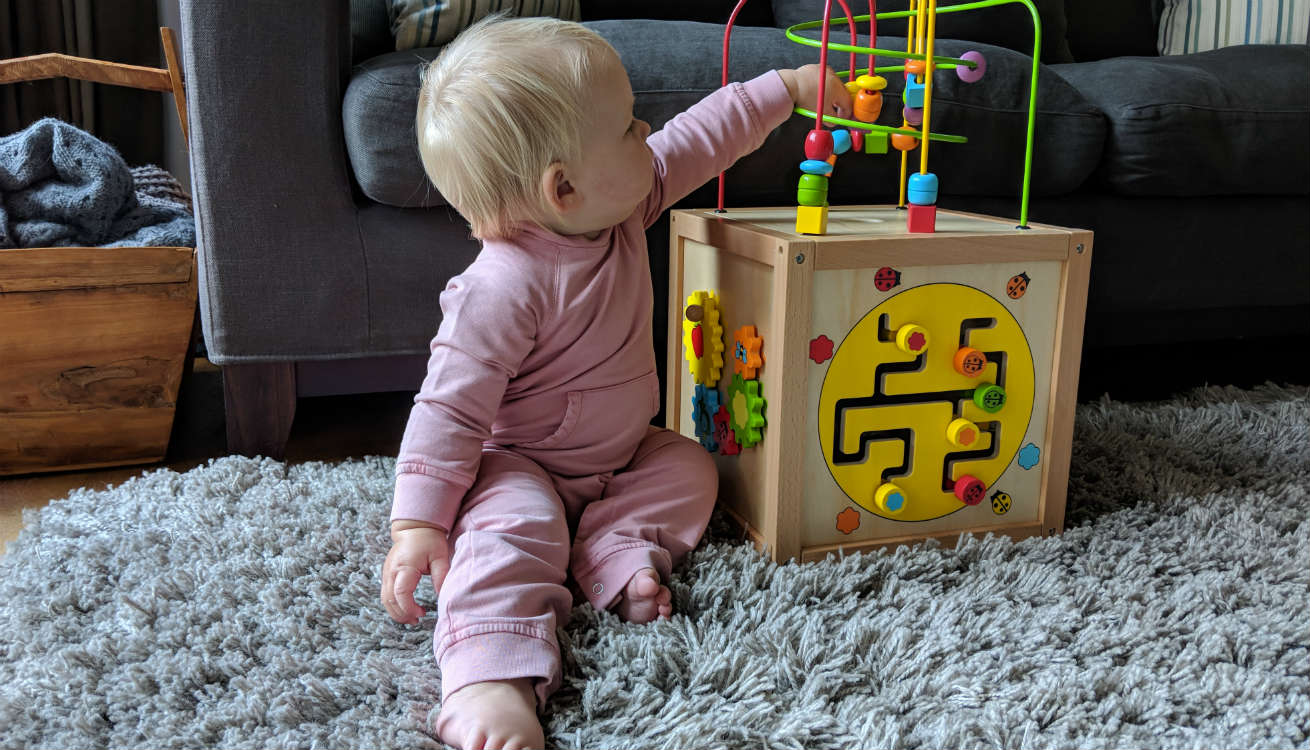 Hermione playing with the Classic World Cube