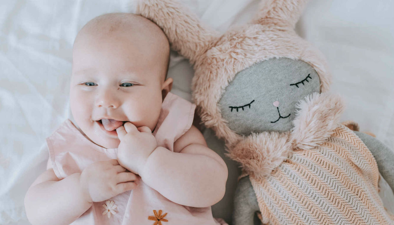 The OYOY Hopsi Bunny Doll is a stylish pick as a baby's first Christmas Gift
