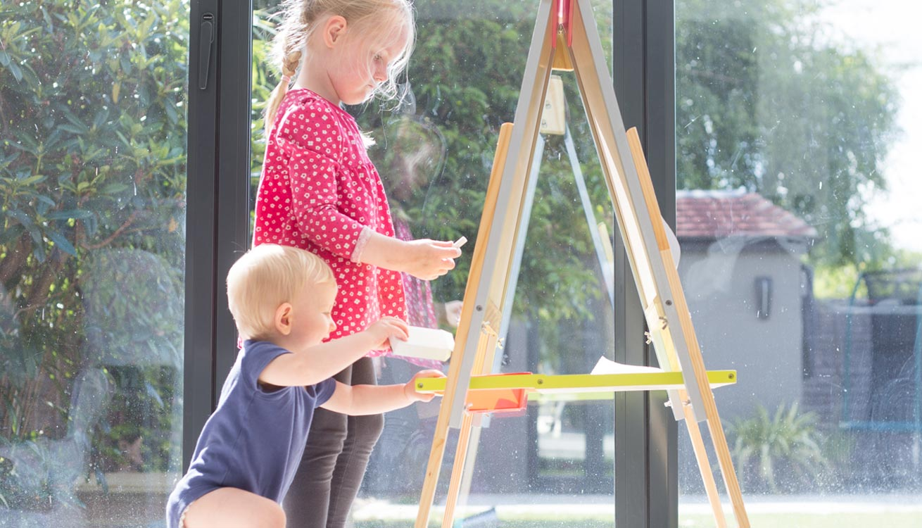 Sienna and Joey playing with the Janod Easel