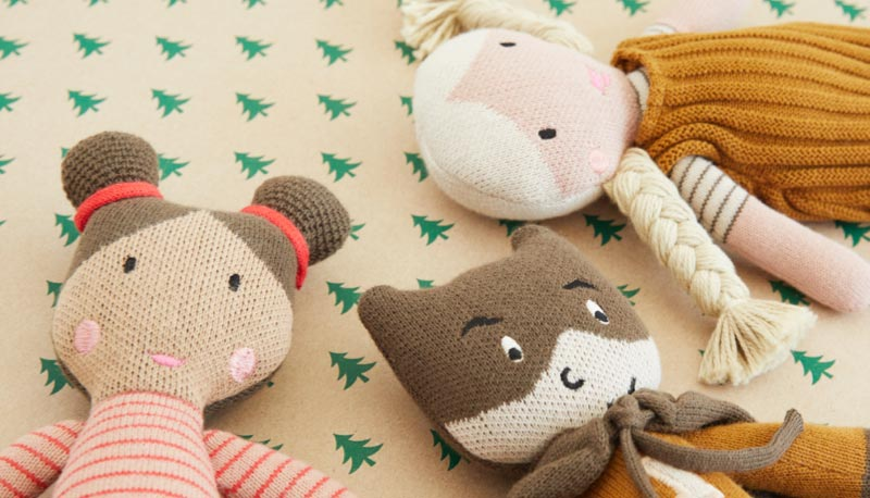 Knitted Liewood dolls on wrapping paper