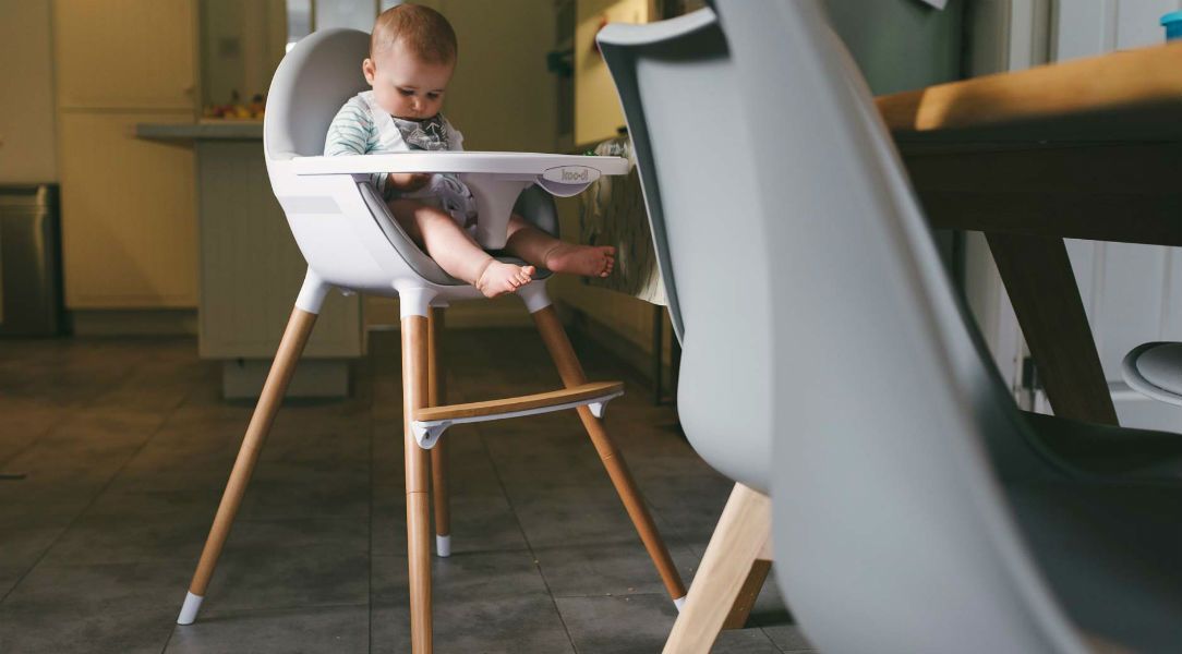 Robyn testing out the stylish Koo-di Duo Wooden Highchair