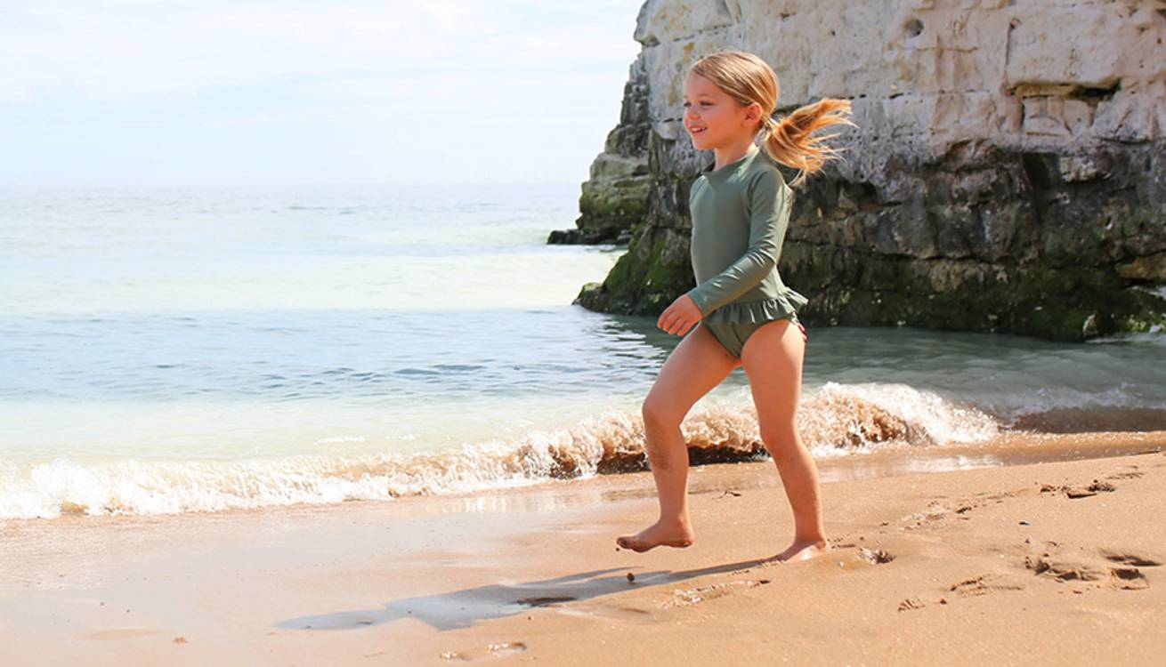 Freya modeling the KIDLY Label Long Sleeve Swimsuit