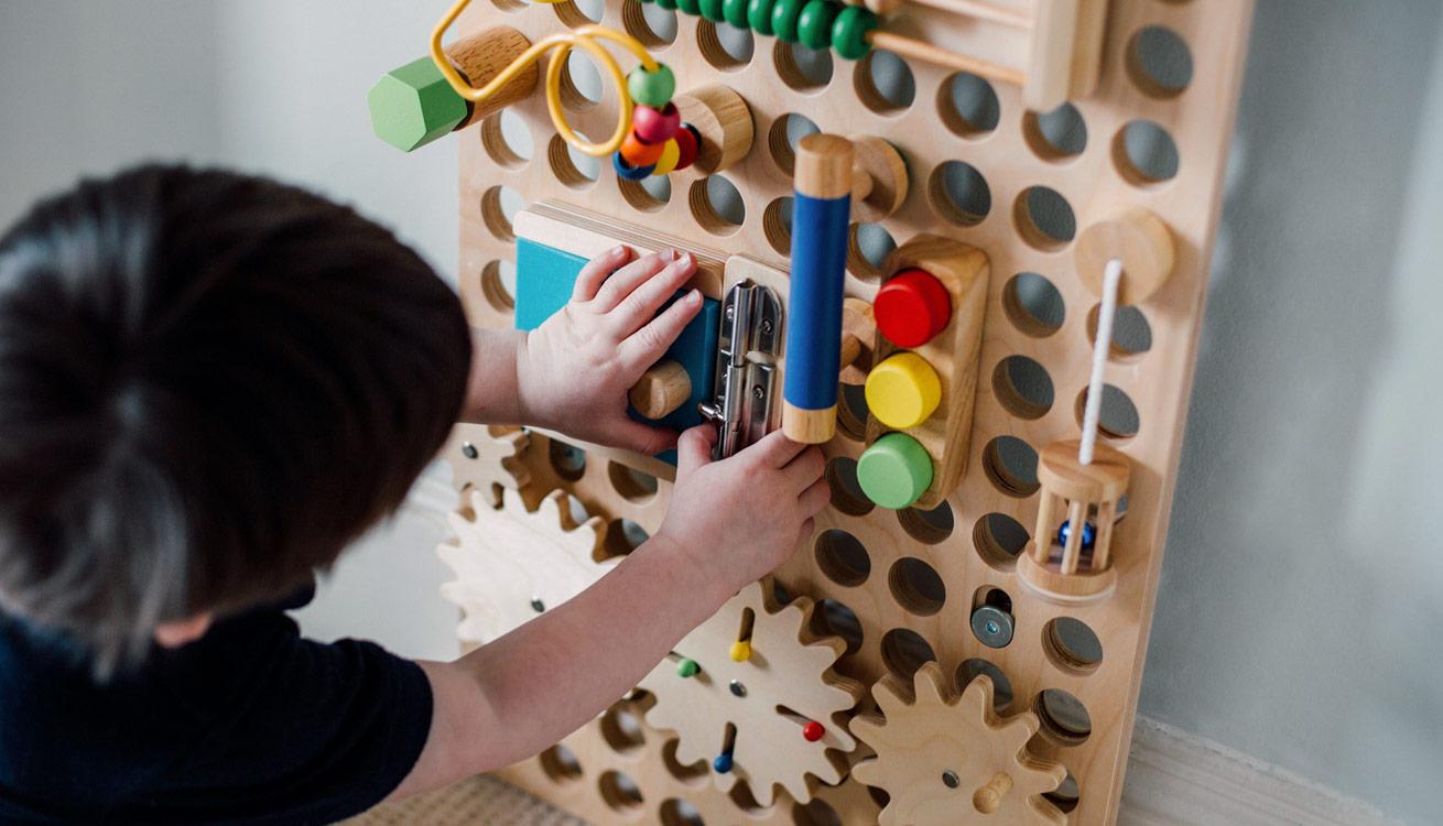 Boy exploring a Muro board
