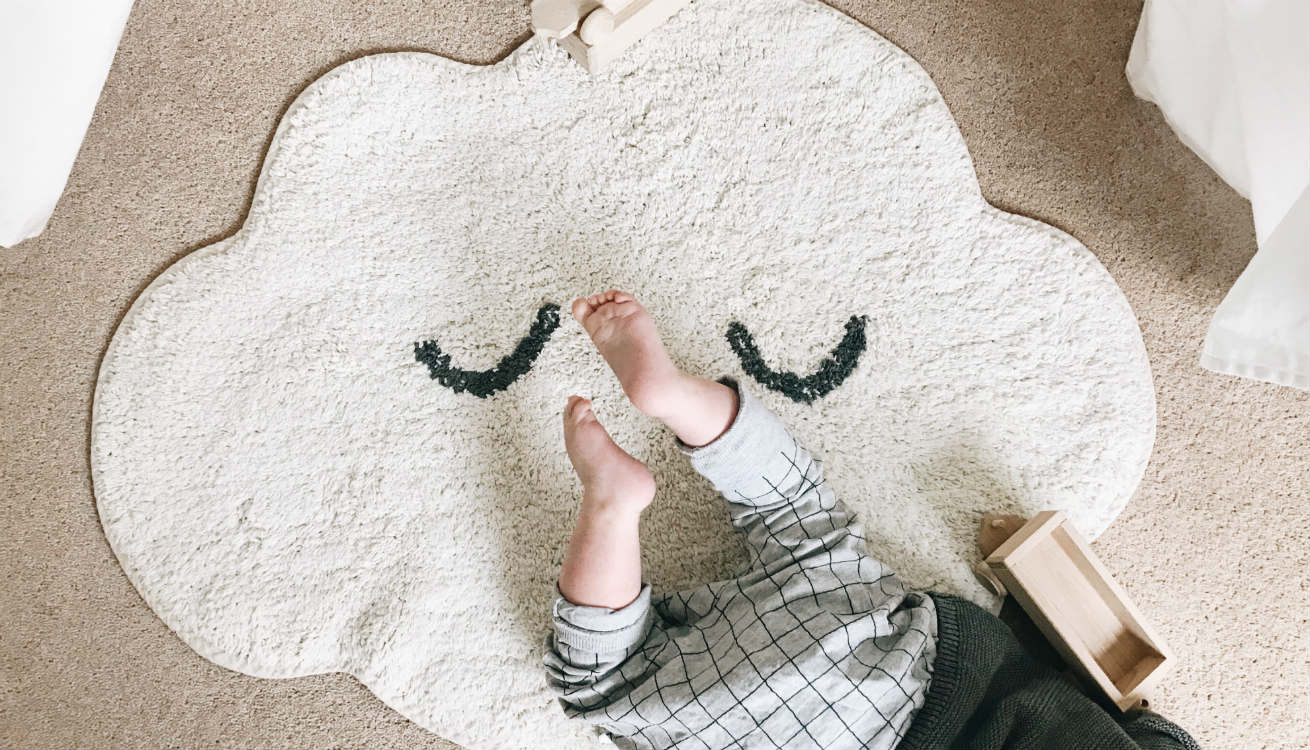 Ellis having fun on the Bloomingville Cloud Rug