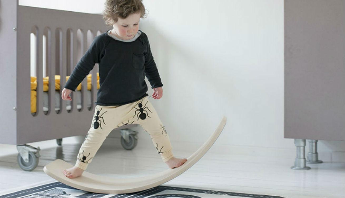 A boy balancing on the Wobbel board