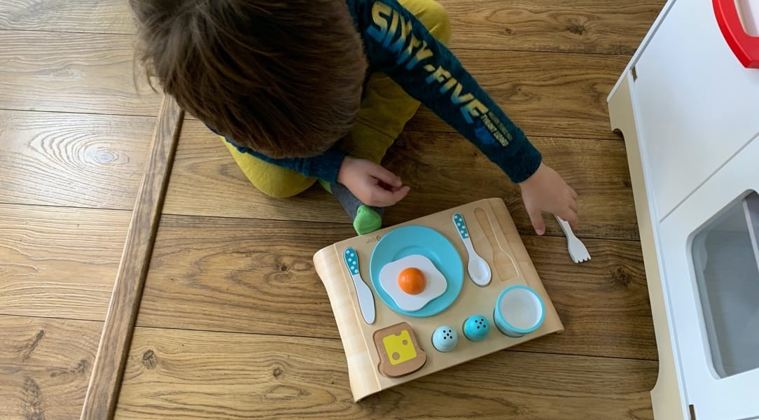 Child playing with Classic Toys Breakfast Set