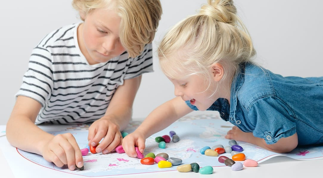 two children using Crayon Rocks to do colouring-in