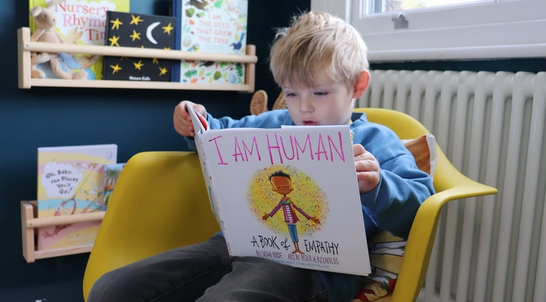 A boy reading a book about mindfulness