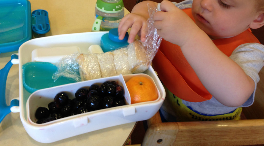 Isaac testing out the Boon Bento Lunch Box