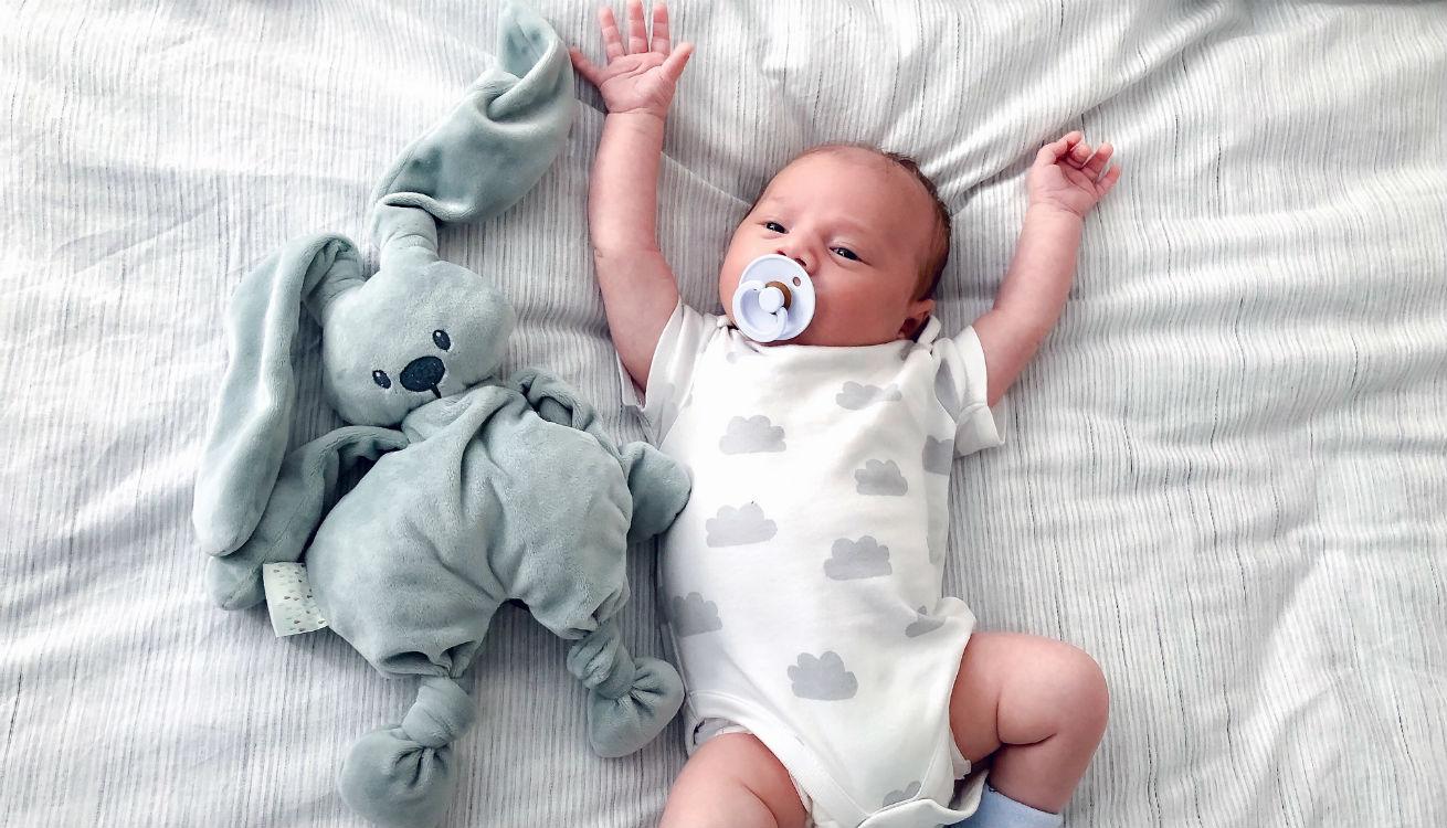 Newborn baby with comforter