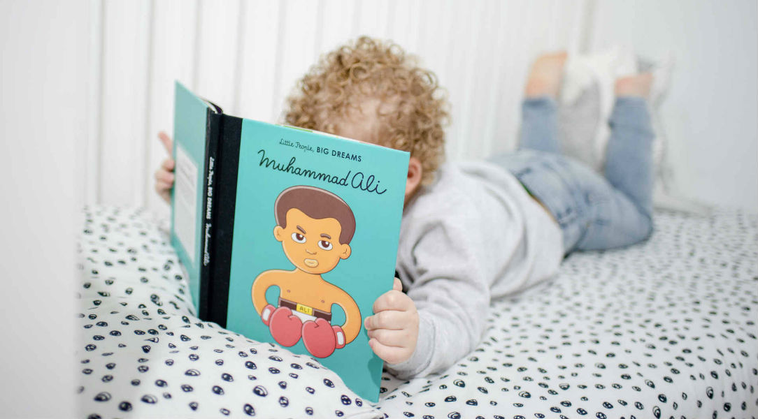 boy reading little people big dreams Muhammad Ali