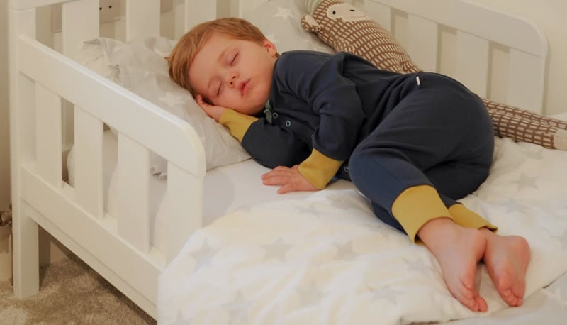 Otto sleeping in his KIDLY Label Organic Onesie