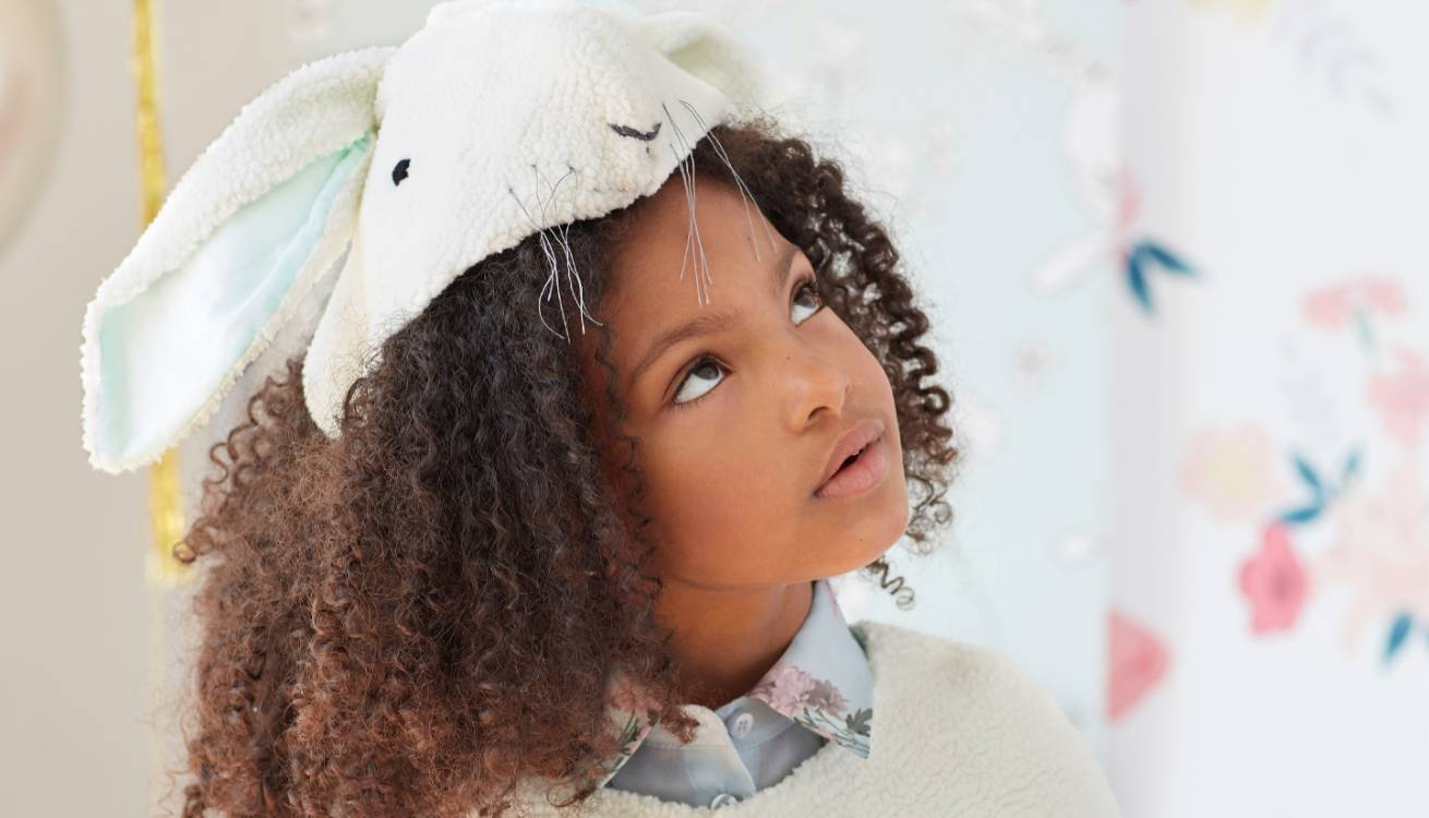 Little girl wearing Meri Meri bunny dress-up