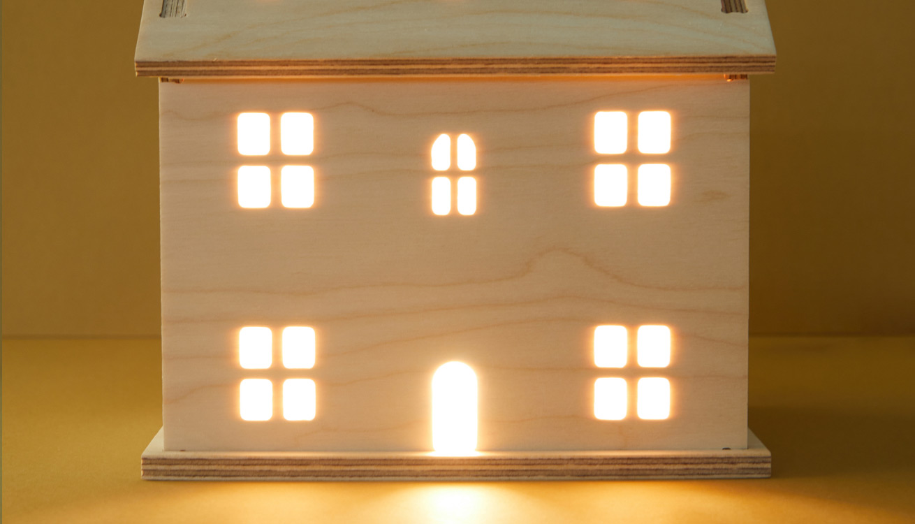Our wooden Welsh Cottage Light glowing