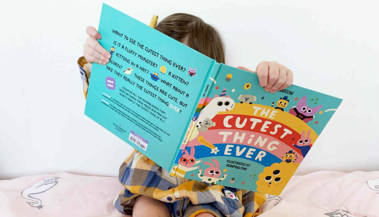 Little girl reading Cutest Thing Ever