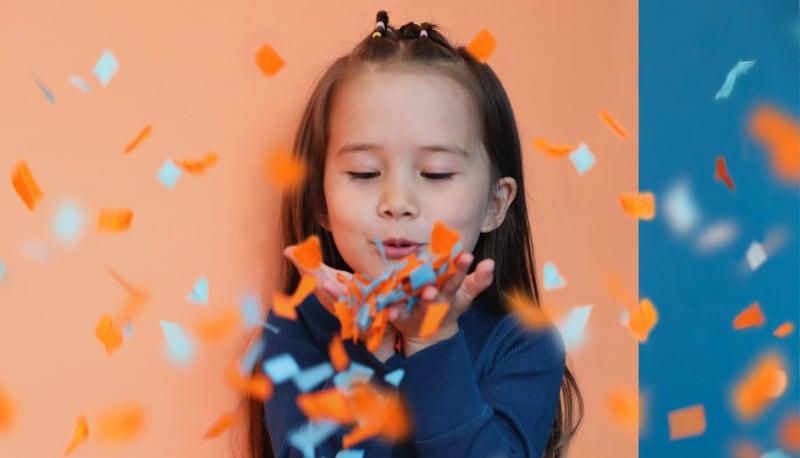 Fei blowing confetti towards you