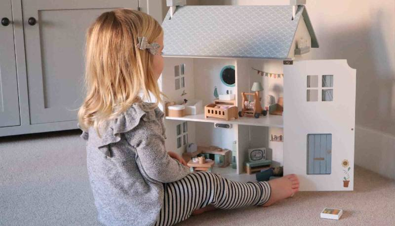 Girl playing with Little Dutch Dolls House
