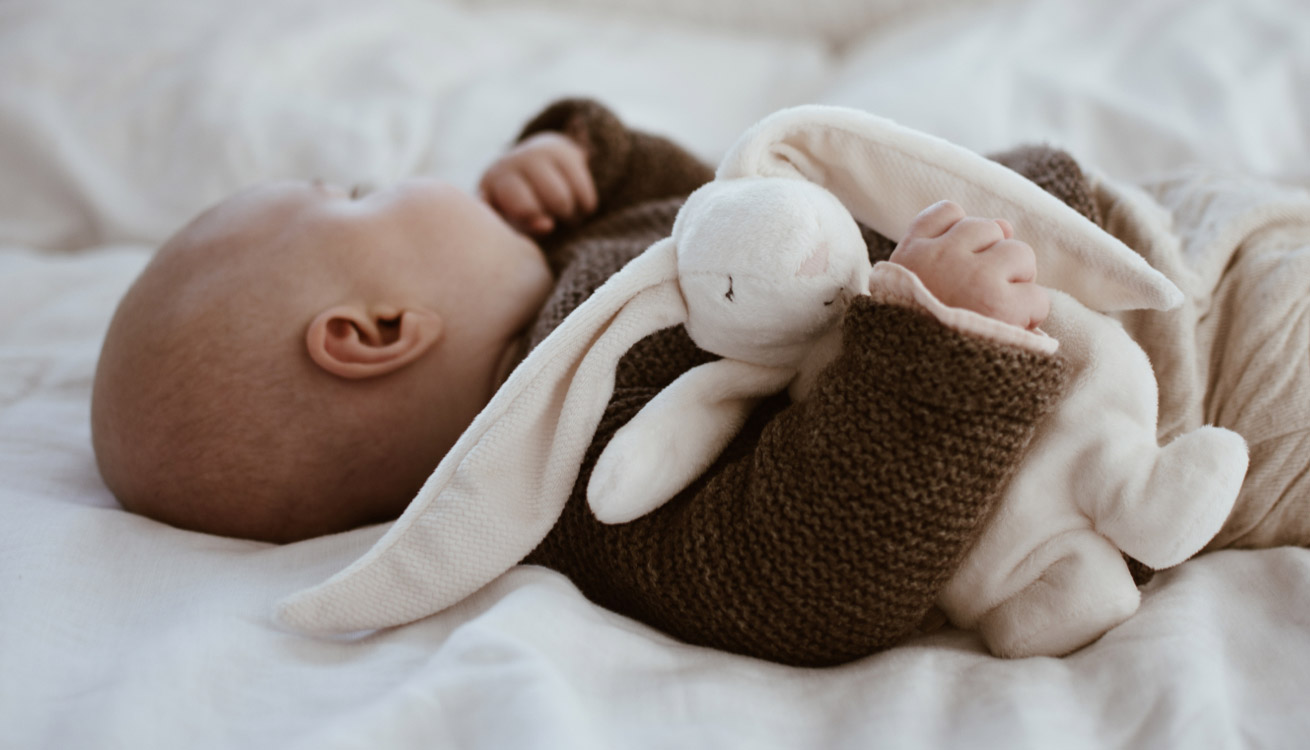 Baby napping with Moonie's Noising Rabbit With A Light