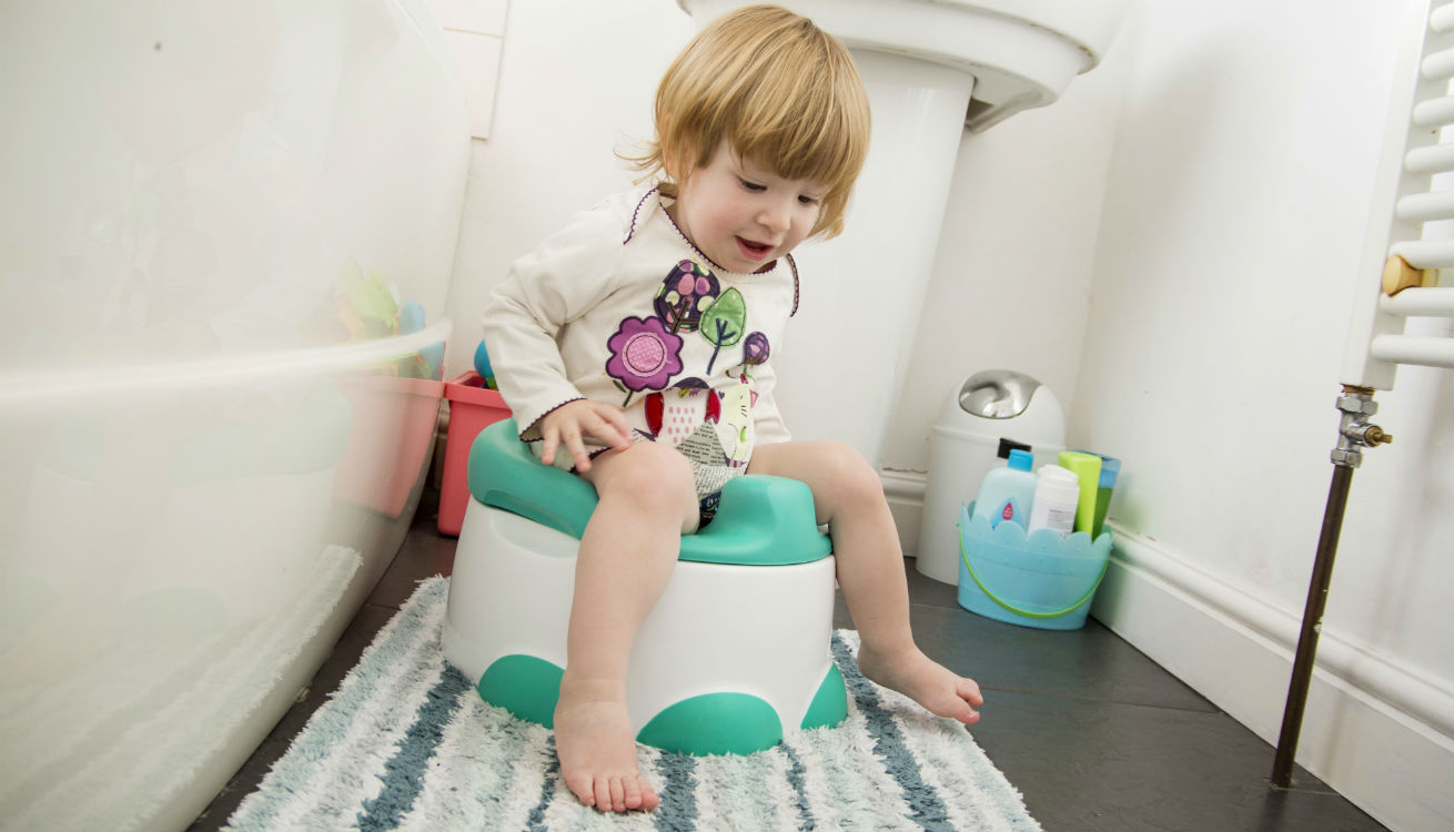 Emily testing out the Bumbo Potty