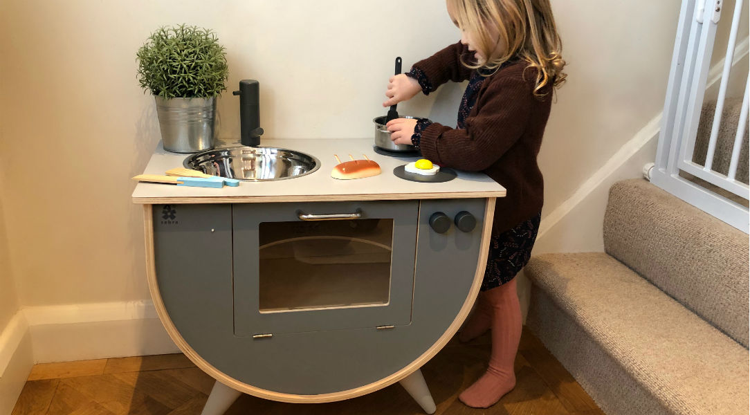 Martha playing with the Sebra play kitchen