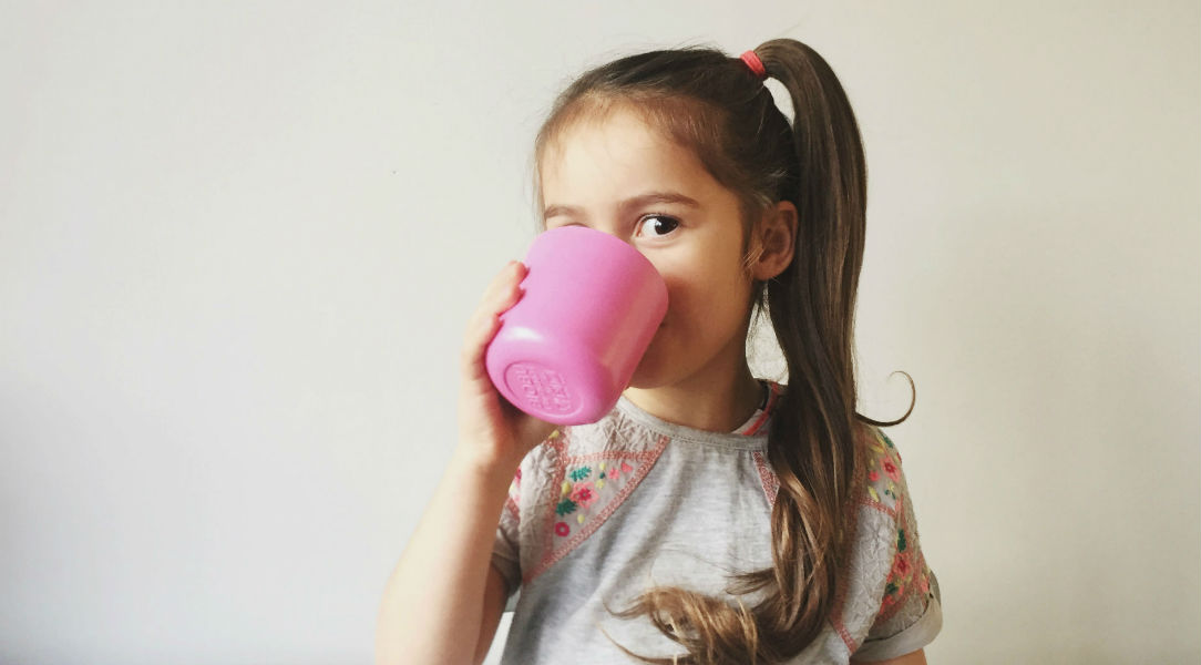 Nora drinking from an EKOBO Cup