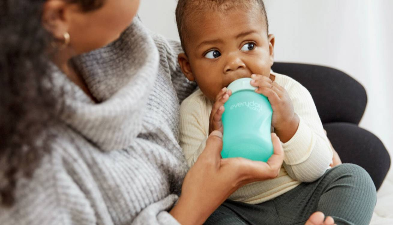Baby drinking from Everyday Baby bottle