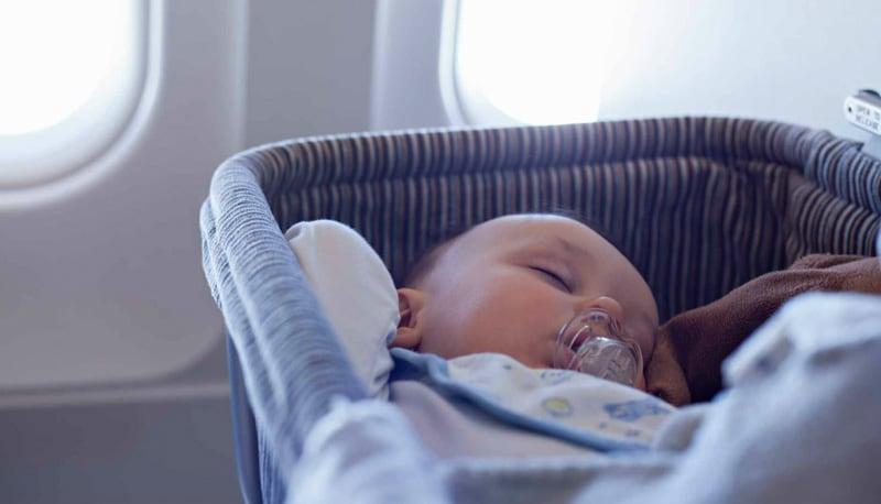 Baby asleep in wicker basket