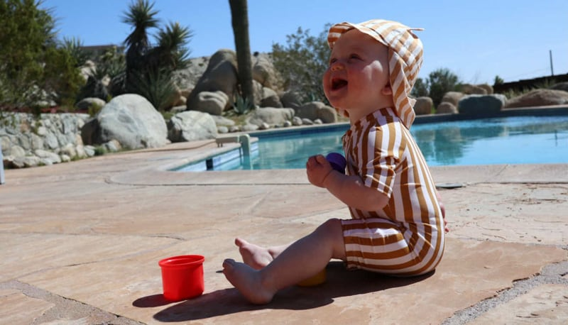 Tallulah in the Liewood Swim Jumpsuit and Gorm Sun Hat
