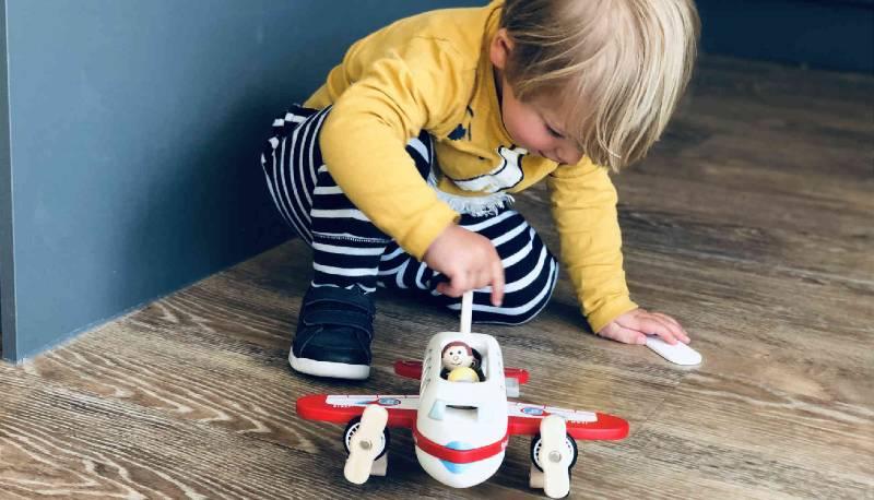 Little boy playing with an Indigo Jamm Flying Felix