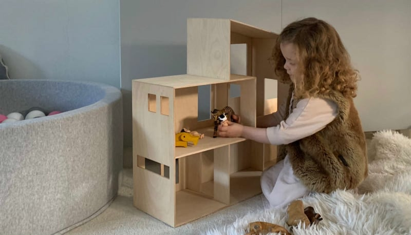 Girl Playing with her Ferm Living Funkis House