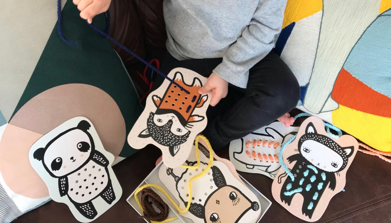 Little hands crafting with Wee Gallery Baby Animal Lacing Cards