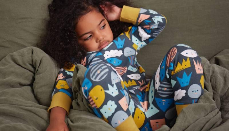 Bronte relaxing in her KIDLY Label Organic Pyjamas
