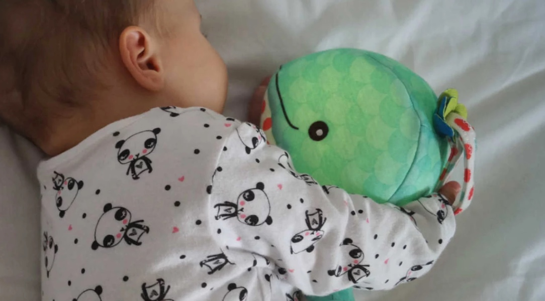 Harper is soothed to sleep by her B. Toys Glow Zzzs Whale