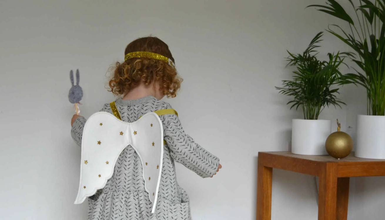 Little girl wearing an angel costume