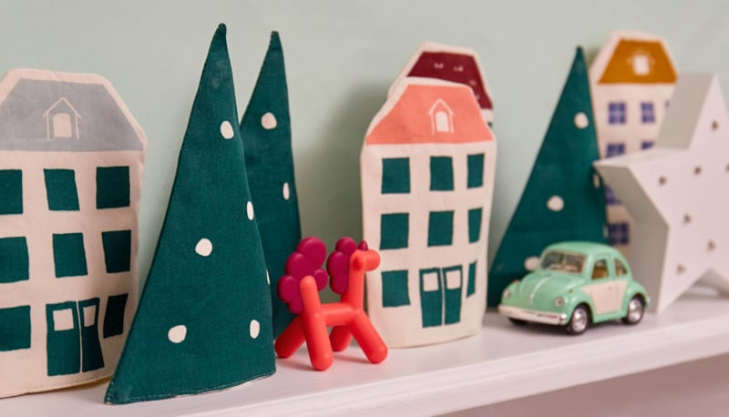 Advent houses & Christmas trees with a retro toy car on a shelf