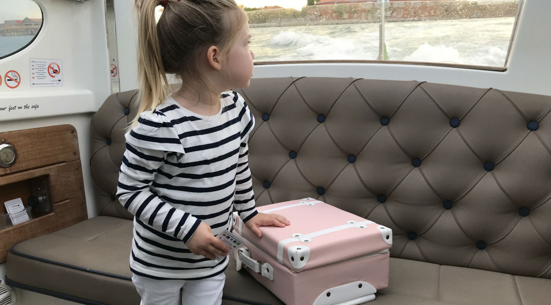 This vintage style suitcase is great for travels and stylish nursery storage