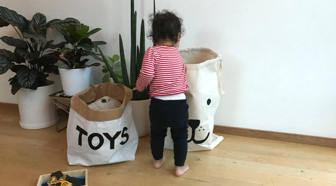 Casper-Grey hunts for his toys in the Tellkiddo bags