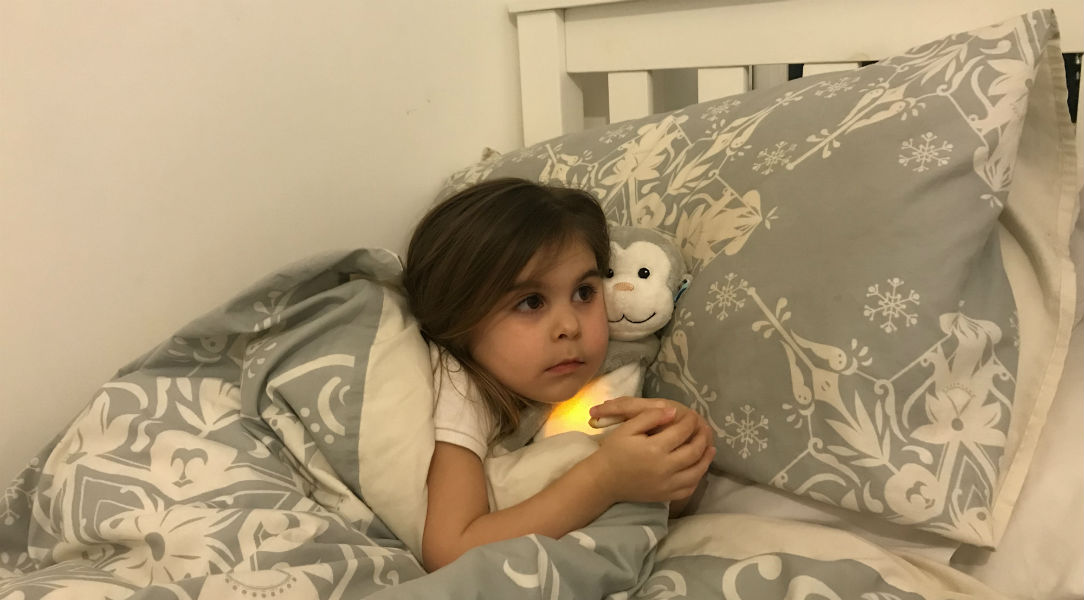 Penelope cuddles up to her Zazu monkey soft toy