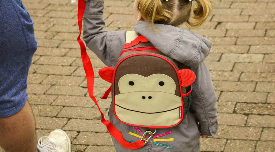 Emily's dad holds onto the reins of her Skip Hop Zoolet Mini backpack