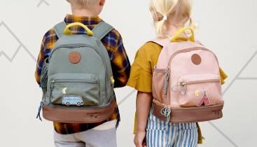 Little girl wearing Sticky Lemon backpack